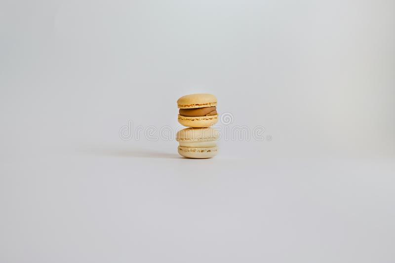 Pyramid of color tasty macarons on the background stock image