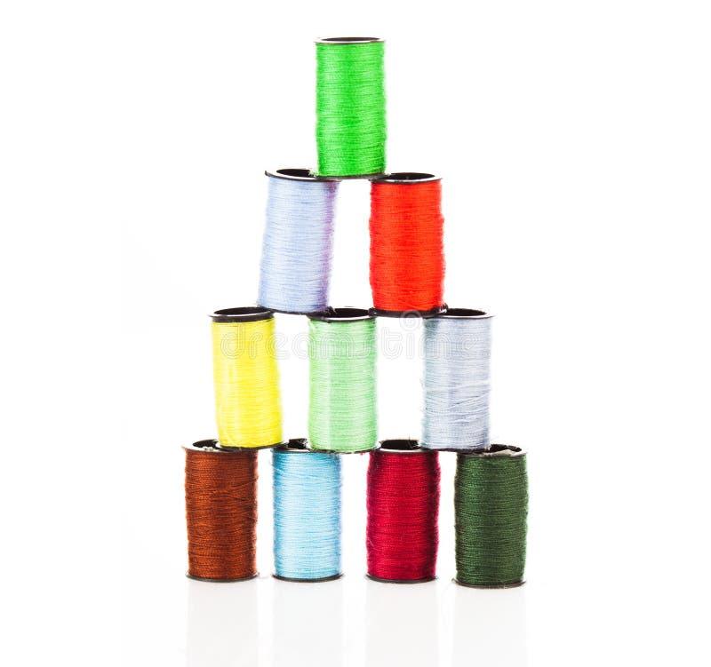 Pyramid of colourful cotton yarns royalty free stock photo