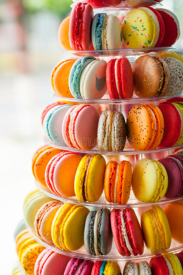 Pyramid of cookies. Sweet sandwich-biscuits different colors, filled with hazelnut cream arranged in a pyramid on display in the store royalty free stock photos