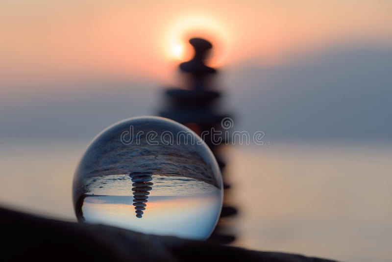 Pyramid and crystal ball stock images