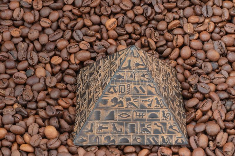 coffee beans and pyramid stock photography