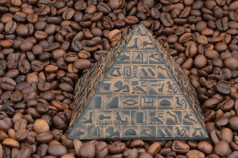 coffee beans and pyramid figurine royalty free stock photo