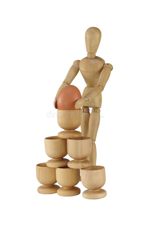 Pyramid från ställningar med ägget och attrappen royaltyfria bilder