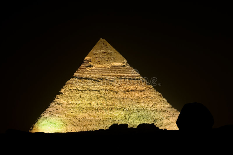 The Pyramid of Kephren (Giza). Night shot for the second Pyramid of Giza (Cephren) in Egypt. The sphinx shows as a silhouette in the foreground of the photo stock image