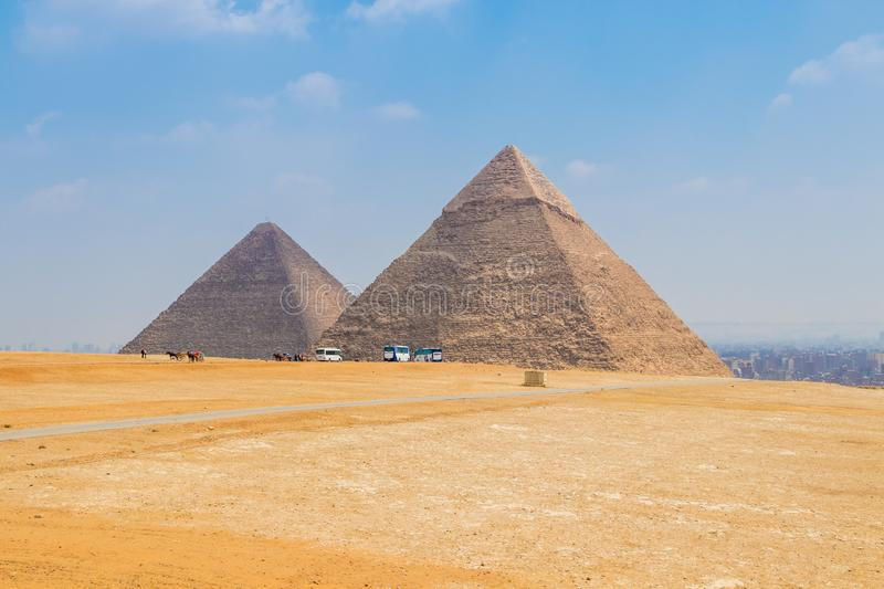 The Pyramid of Khafre and Pyramid of Khufu. The pyramid of Cheops is the first of the seven wonders of the world and the only one of its wonders still standing stock photos