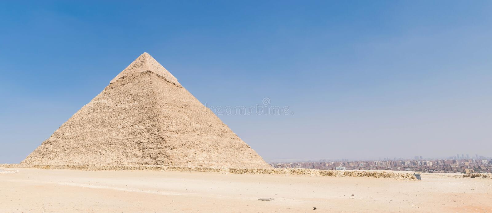 The Pyramid of Khafre and panorama of Cairo. The Pyramid of Khafre or of Chephrenis the second-tallest and second-largest of the Ancient Egyptian Pyramids of royalty free stock photos