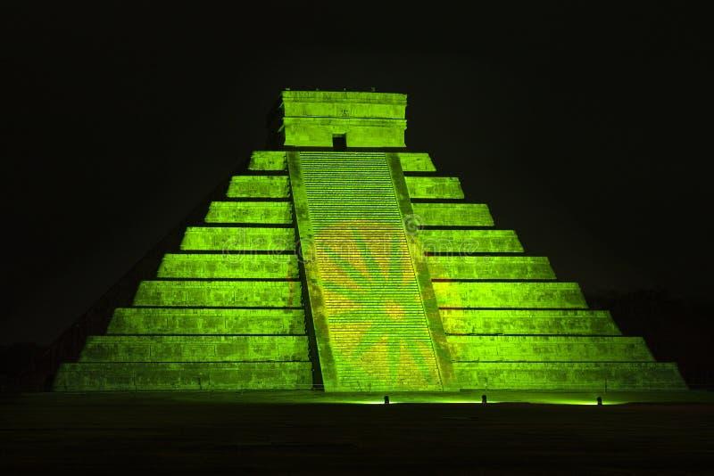 Pyramid of Kukulkan at Chichen Itza. Illuminated by a green light royalty free stock photography