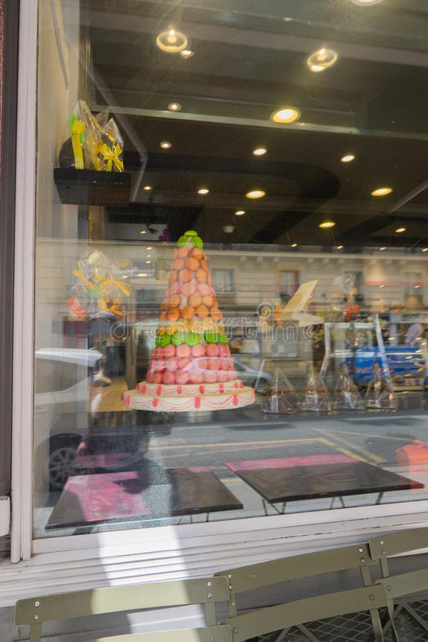 The pyramid of macaroon cakes in a candy store royalty free stock photography