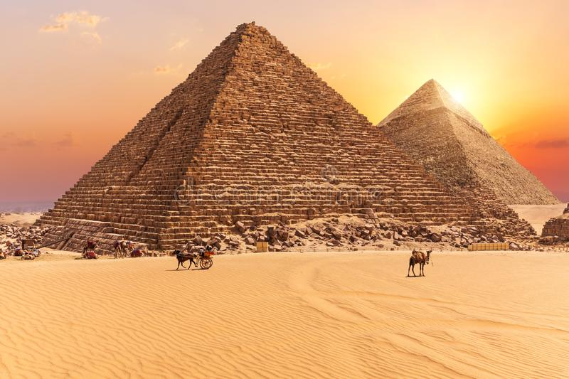 The Pyramid of Menkaure and the Pyramid of Khafre in the sunset rays, Giza desert royalty free stock photos