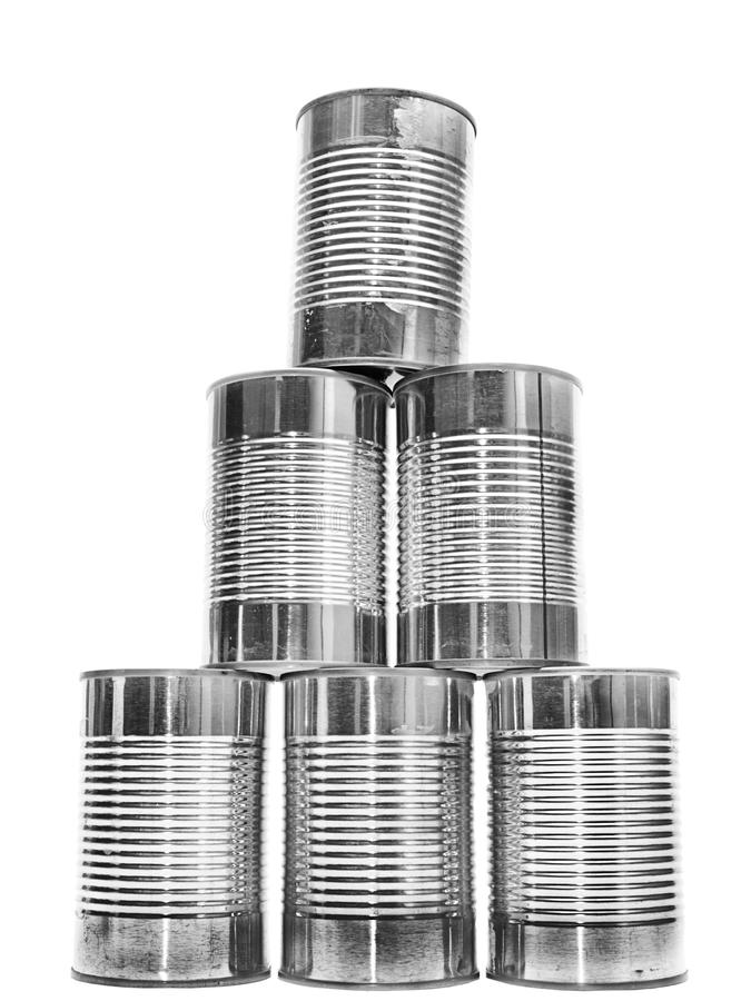 Pyramid of metal cans on white stock images