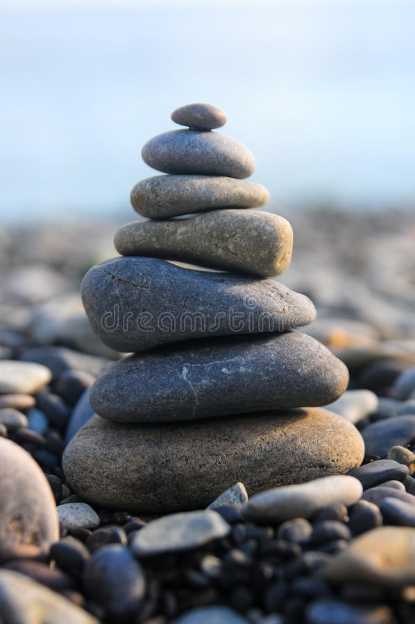 Pyramid of pebble stones. Stone stack on pebble beach stock photography