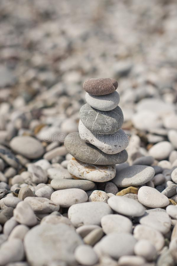 The pyramid of pebbles on the beach 8644. A pyramid of stacked flat pebble stones royalty free stock photo