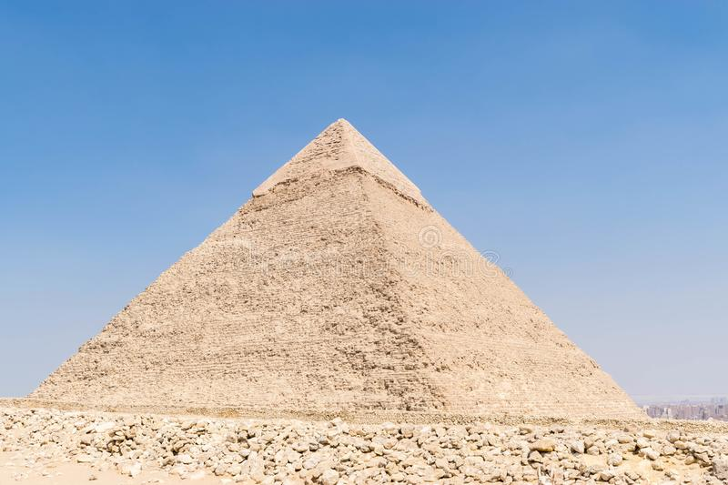 Pyramid of Pharaoh Khafre, Egypt. The Pyramid of Khafre or of Chephren is the second-tallest and second-largest of the Ancient Egyptian Pyramids of Giza and the royalty free stock photo