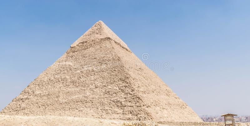 Pyramid of Pharaoh Khafre in Giza. The Pyramid of Khafre or of Chephren is the second-tallest and second-largest of the Ancient Egyptian Pyramids of Giza and the stock photos