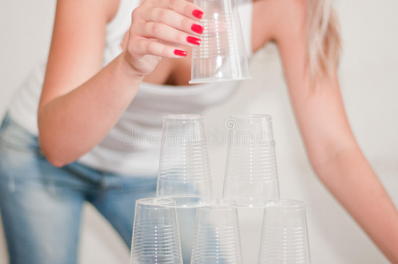 The pyramid of plastic cups. A pyramid of plastic cups royalty free stock photography