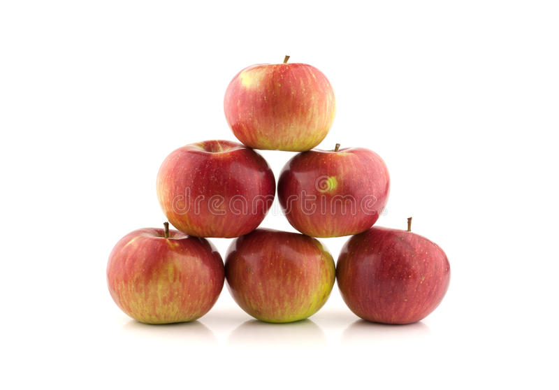 Pyramid of red apples. Isolated on white background stock photography