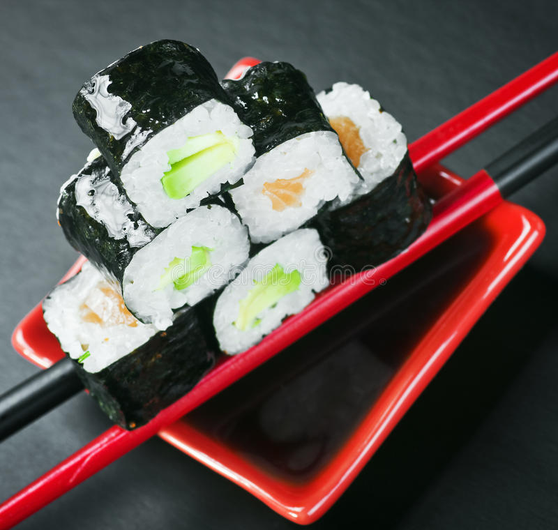 Pyramid of rolls on sticks for sushi stock image