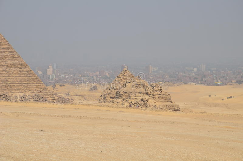 Pyramid in sand dust under gray clouds royalty free stock photography