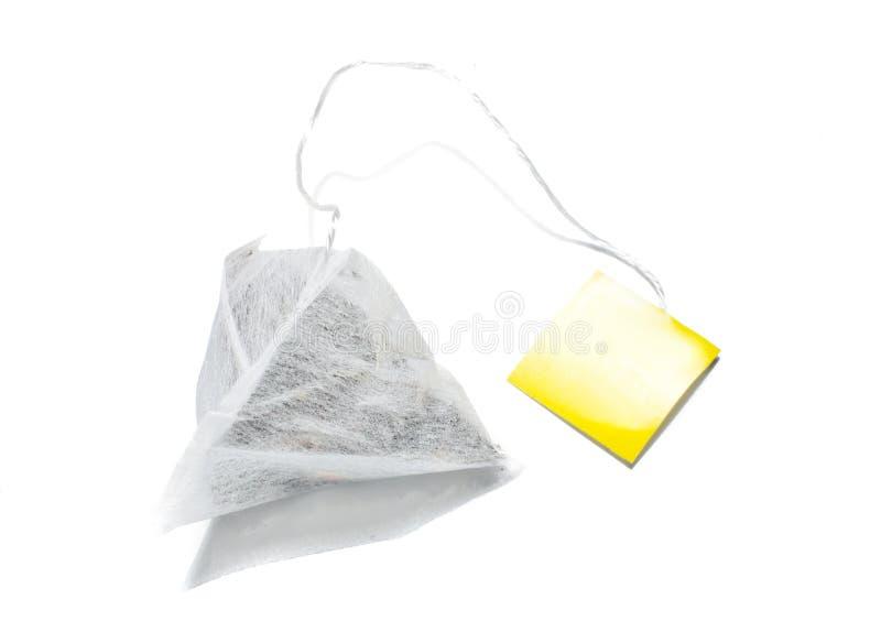 Pyramid shape teabag isolated royalty free stock photo