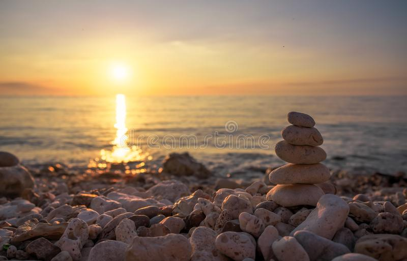 Pyramid of the small pebbles on the beach. Stones, against the background of the sea shore royalty free stock image