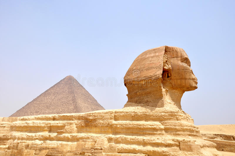 Pyramid and Sphynx. The giant pyramid Giza and Sphynx in Cairo, Egypt stock photo