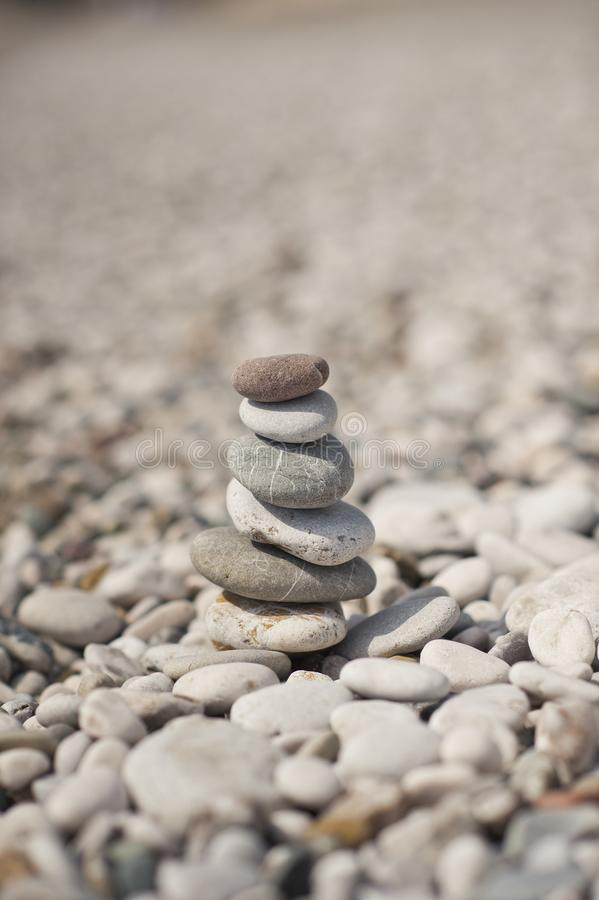 The pyramid of pebbles on the beach 8645. A pyramid of stacked flat pebble stones royalty free stock images