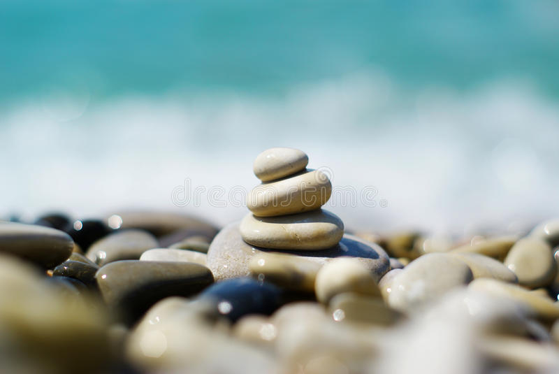 Pyramid from stones. At sea stock images