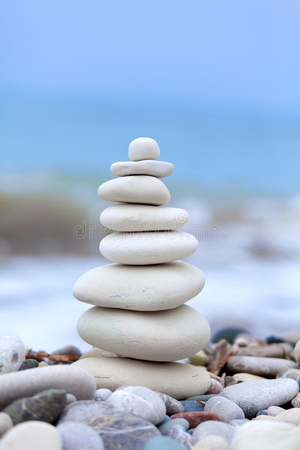 Pyramid of stones. On Cyprus beach stock photo