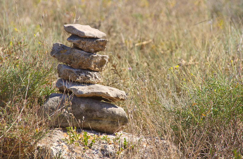 Pyramid from stones. In steppe royalty free stock images