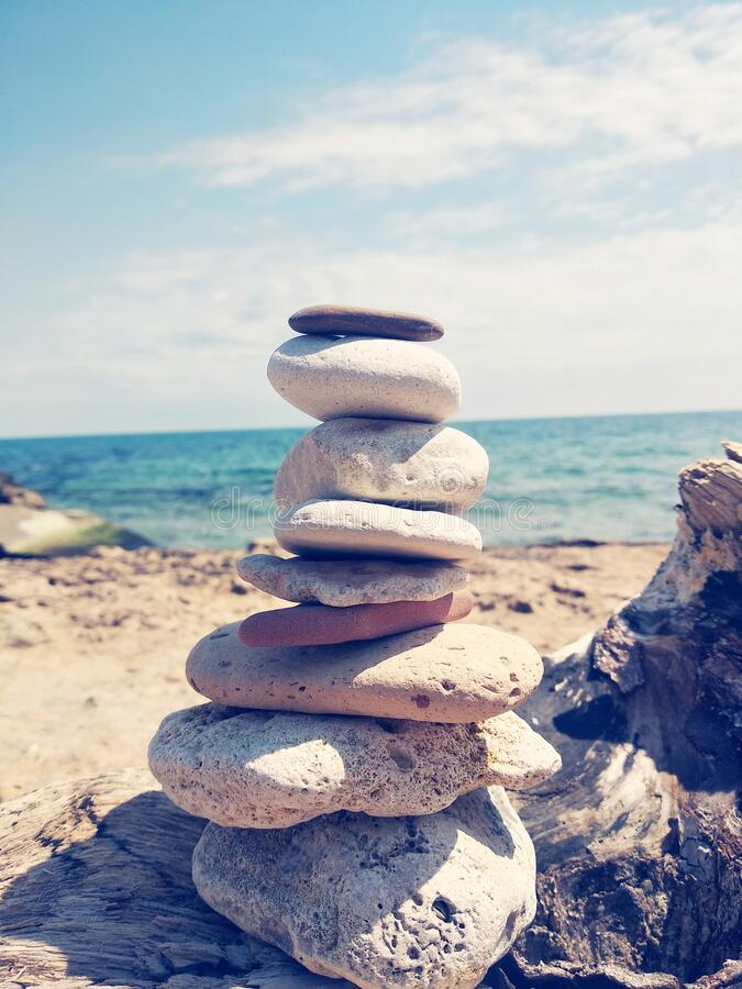 Pyramid of stones on the background of the sea royalty free stock images