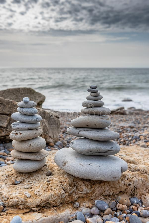 Pyramid of stones. Cairn, Pyramid of stones on the sea royalty free stock photo