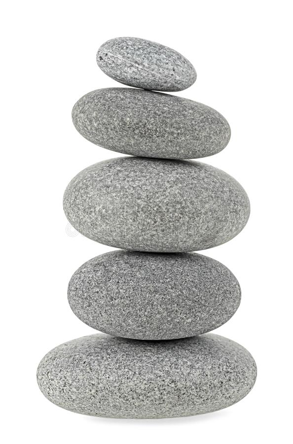 Pyramid of the stones isolated on white background. Pyramid of the stones isolated on a white background royalty free stock images