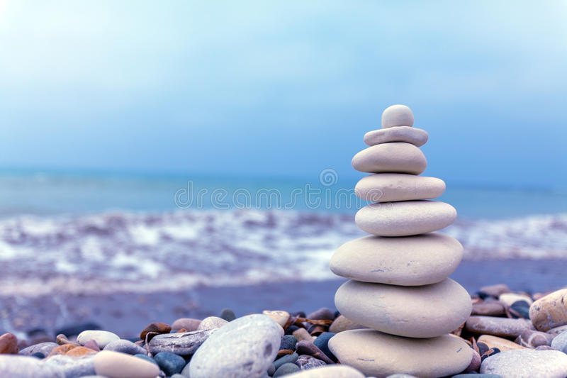 Pyramid of Stones near Sea on Beach stock image