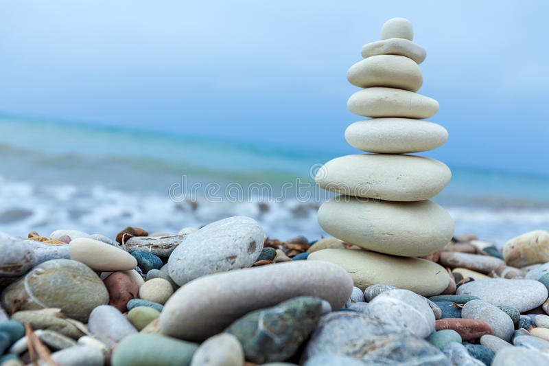 Pyramid of Stones near Sea on Beach stock photography