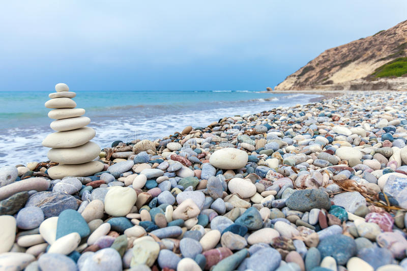 Pyramid of Stones near Sea on Beach stock photos