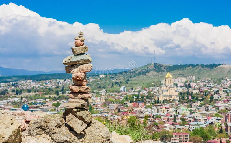 Pyramid of stones and panoramic view of Tbilisi city. Georgia. Pyramid of stones and panoramic view of Tbilisi city stock photo