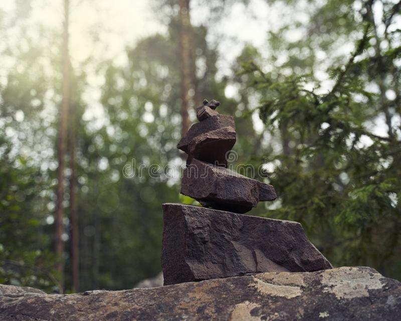 Pyramid of stones, a symbol of the wild Northern nature of Karelia. Coniferous forest stock photo