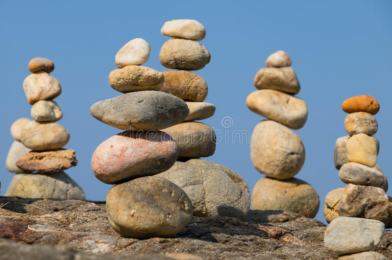 Pyramid from stones. Under a blue blue sky royalty free stock photos