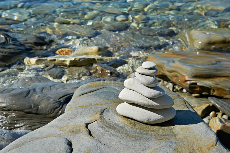 Pyramid of stones zen balance royalty free stock images