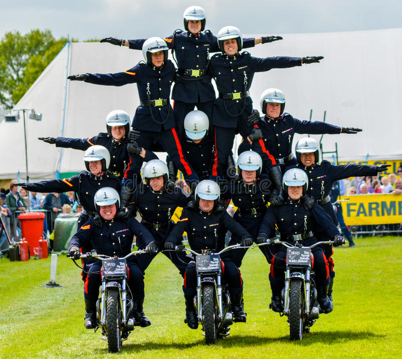 Pyramid Stunt Motorbike Riders royalty free stock photography