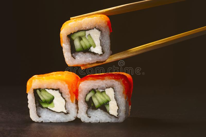 Pyramid of sushi, rolls on a slate board with chopsticks, food background, Japanese cuisine royalty free stock photo