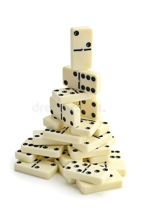 Pyramid of white dominoes isolated on white royalty free stock image