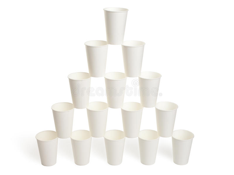 Pyramid of white paper cups. Pyramid of white disposable paper cups isolated on white background royalty free stock image