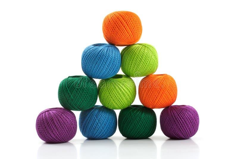 Pyramid of yarn for knitting stock image