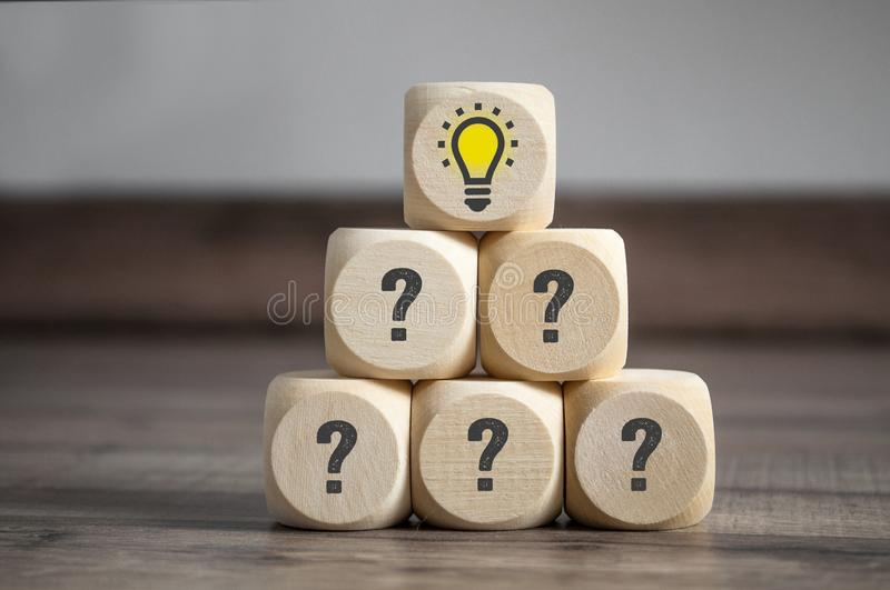 Pyramide made of cube and dice with question tags and light bulb - metaphor for problem and solution royalty free stock photos