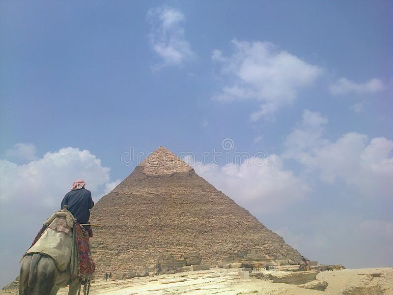 Pyramids of Egypt. The middel pyramid of Egypt behind a camel rider royalty free stock photography
