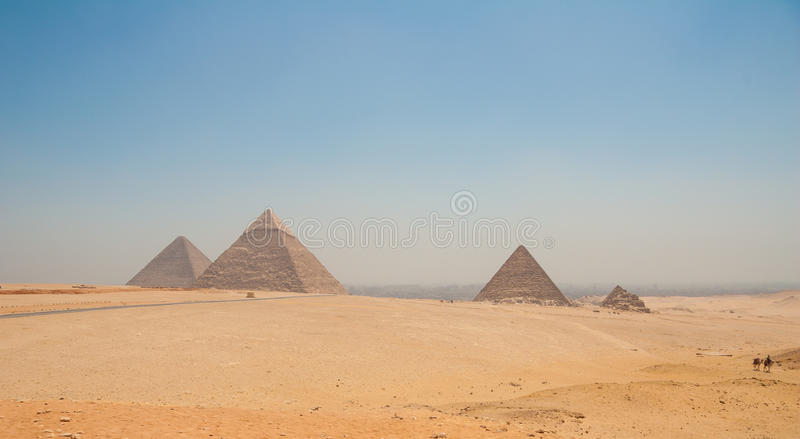 Pyramids of Giza, Cairo, Egypt and camels in the foreground. Pyramids of Giza, three 4th-dynasty (c. 2575–c. 2465 bce) pyramids erected on a rocky plateau stock photo