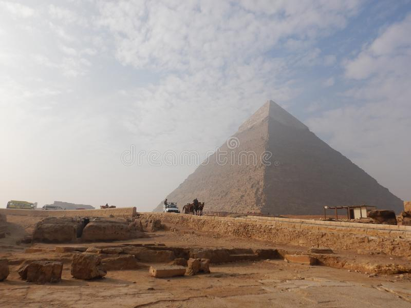 Pyramids of Giza Egypt. With car passing by stock photography