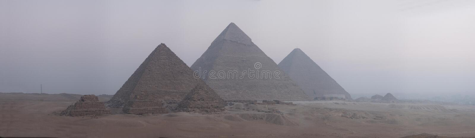 Pyramids panorama 5000 pixels wide. Large sized panorama image of the Gizeh Plateau near Cairo. Pyramids of Cheops, Chefren and Mycerinus at sunrise royalty free stock images