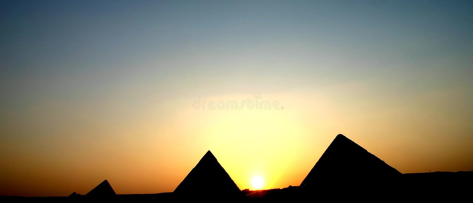 Pyramids sunset royalty free stock images